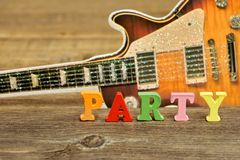 Sign PARTY and Electric Guitar Silhouette on the Background Royalty Free Stock Image