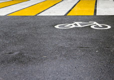 The sign on the pavement, pedestrian crossing. Bicycle sign on the asphalt, pedestrian crossing Royalty Free Stock Images