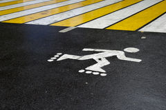 The sign on the pavement, pedestrian crossing. Bicycle sign on the asphalt, pedestrian crossing Royalty Free Stock Photos