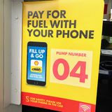 A sign ` pay for fuel with your phone` royalty free stock image
