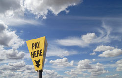 Sign pay here. Blue sky Royalty Free Stock Photo