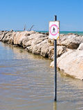 Sign of pedestrian prohibited in the sea. A sign of pedestrian prohibited in the Adriatic sea Royalty Free Stock Image