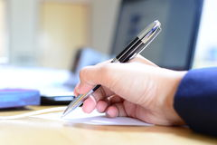 Sign pen in business woman hand Stock Image