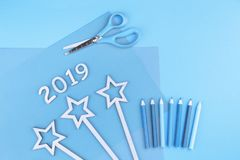 2019 sign with pencils and stars blue monochrome flat lay stock image