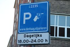 Sign that people have to pay for parking in this street daily between 18:00 and 24:00 hours in Den Haag. royalty free stock photo