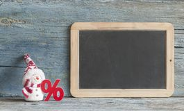 Sign Percent And Cute Snowman On Wood Background Royalty Free Stock Image