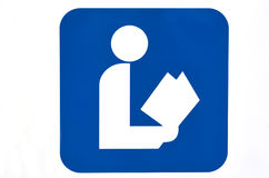 Sign of a person read a book. Blue sign of a person read a book isolated on white background. Concept photo of education, reading, books, publishing, news, study Stock Photo