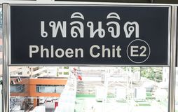 Sign for Phloen Chit station. Sign in Thai and English for Phloen Chit station on the Sukhumvit line of the Bangkok Skytrain stock photo