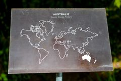 A sign with a picture of a map highlighting Australia. Sign Stock Photography