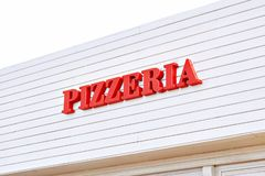Sign Pizzeria on cafe stock image