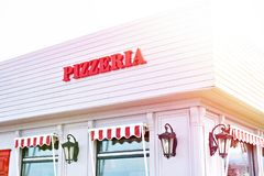 Sign Pizzeria on cafe. Sign Pizzeria on the facade of the cafe royalty free stock photography