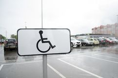 Sign `the Place for people with disabilities`. Parking.. stock photo
