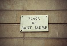 Sign Plaza de Sant Jaume in Barcelona. Sign on the wall of a building in Barcelona with the name Plaza de Sant Jaume. Famous square on which the building of the Royalty Free Stock Images