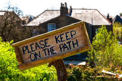 Sign of Please Keep On The Path. Wooden sign of Please Keep On The Path stock photos