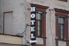 Sign `Hotel` on the wall stock photo