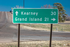Sign pointing to Kearney and Grand Island Nebraska - midwestern America, along Interstate Highway 80 Stock Photo