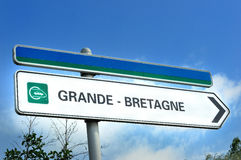 Sign pointing towards the chunnel to Grand Bretagne or Great Bri Stock Photos