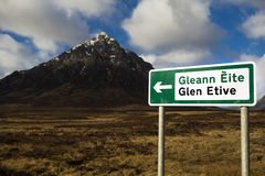 Sign pointing way to glen etive. In the scottish highlands, with the mountain stob derg in the background Stock Image