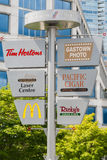 Sign pole with on Waterfront Centre park, Vancouver Stock Photo