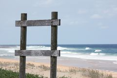 Sign Poles by the beach Stock Photography