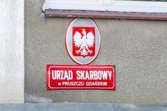 Sign of Polish government revenue office in Pruszcz Gdanski Polish: Urzad Skarbowy w Pruszczu Gdanskim.  Royalty Free Stock Image