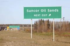 Sign post in Alberta, Canada. Suncor Oil Sands direction sign post, Alberta, Canada Royalty Free Stock Photography
