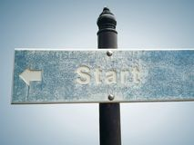 Sign Post with Arrow and Word Start Isolated on Gradient Background stock image