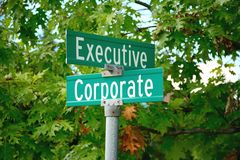 Sign post of corporate executive Royalty Free Stock Images