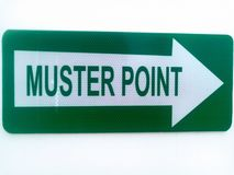 Sign, post, direction, muster point, safety stock photography