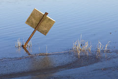 Sign post in flood water Stock Photos