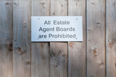 Sign post outside a property 'All Estate Agent Boards Are Prohib. Ited Stock Photos