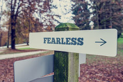 Sign Post Showing Direction to Fearlessness Stock Photos