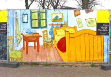 Painting 'The Bedroom' of Vincent van Gogh and museum sign in Amsterdam Royalty Free Stock Images