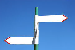 Sign post with two arrows Royalty Free Stock Photo