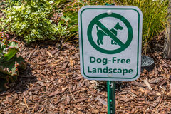 Sign Posted to Prohibit Access of Dogs on Landscaping Stock Photography