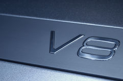 Sign of power. The sign of a big, powerful engine, eight cylinders arranged in the 'V' configuration. This symbol is embossed on the top cover of a Volvo engine Royalty Free Stock Photography