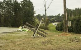 Sign and Power Pole Damage from Tornado. `Sign and Power Pole Damage from Tornado`, is a photo taken on Smith Road, in Fortson, Georgia royalty free stock photography