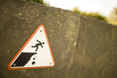 Sign precaution fall. Neat to the beach Stock Images