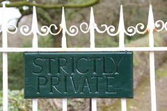 Sign on a private property. Strictly private sign on a white metal gate at the entrance of the property Stock Photo