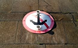 Sign prohibiting moored on the waterfront in St. Petersburg - the crossed anchor. In Russia Royalty Free Stock Photography