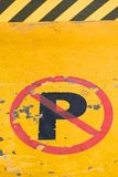 A sign prohibiting parking. In front of a yellow metal gate. Vietnam Stock Photos