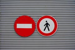 Sign prohibiting pedestrian access. On metal wall Royalty Free Stock Photo