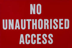 Sign prohibiting unauthorized access Stock Photos