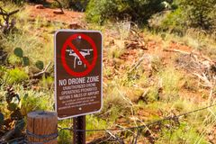 Sign prohibiting the use of a drone in the red rock canyons and sandstone. Sign prohibiting the use of a drone in the red rock canyons and sandstone of Sedona Stock Photo