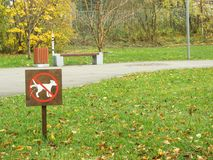 A sign prohibiting walking the dogs. A sign prohibiting walking the dog Stock Images