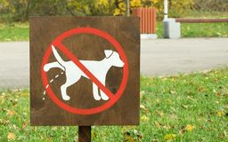 A sign prohibiting walking the dogs. A sign prohibiting walking the dog Stock Photo