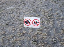Sign prohibiting the walking of dogs on the lawn.  Royalty Free Stock Image