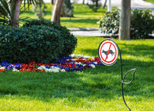 Sign prohibiting walking dogs. Sign in park prohibiting walking dogs Royalty Free Stock Image