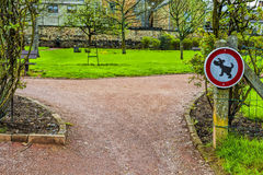 Sign Prohibiting Walking Dogs Stock Photo