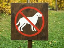 A sign prohibiting walking the dogs. A sign prohibiting walking the dog Royalty Free Stock Photography
